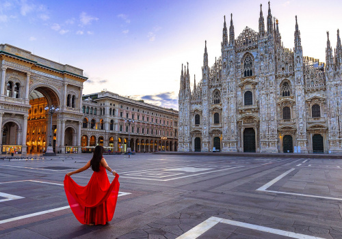 milan cathedral and a lady with a red dress