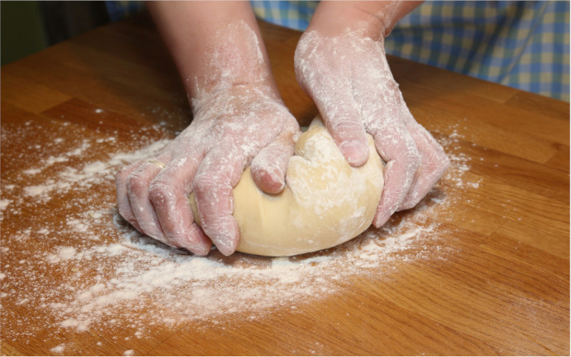 flour and hands in the dough