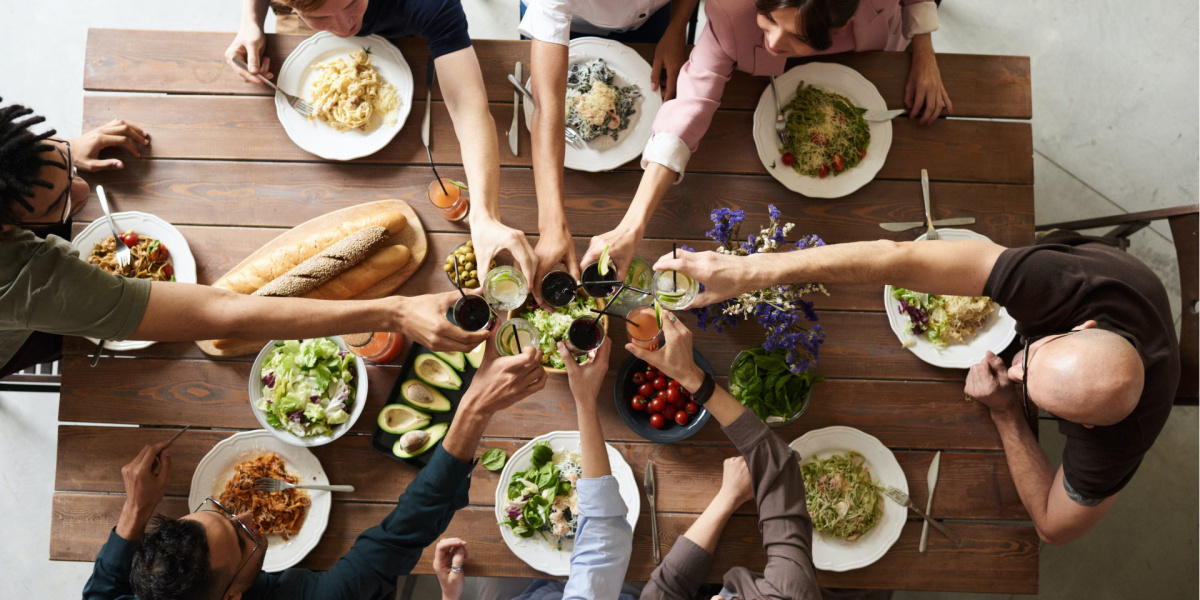 top view of people at the table with food